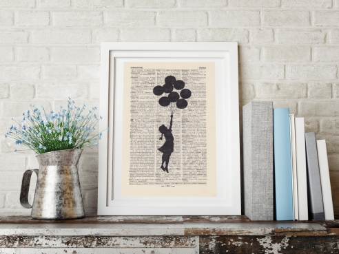 Banksy's Flying Girl - Print on antique book page